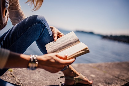 Reading by a lake.