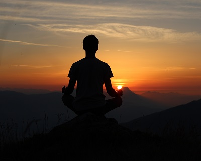 indian-yogi-yogi-madhav-727510-unsplash. Meditation on mountain.