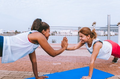 Photo by Luis Quintero from Pexels. Studies have shown that working out with a friend can help you burn more calories.
