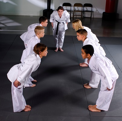 Children learn respect through martial arts training.