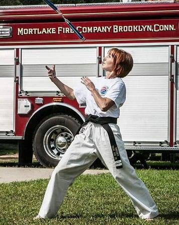Audrey Hussey at an outdoor nunchaku demonstration.