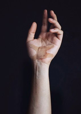 brian-patrick-tagalog-681929-unsplash Cover injuries with bandaids.