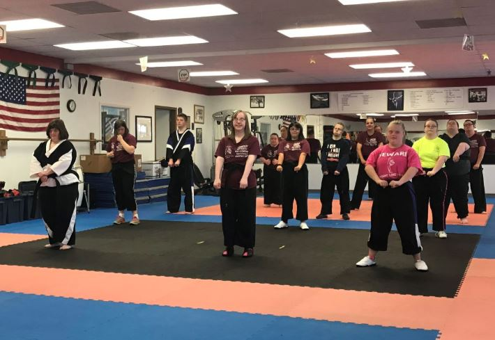 A class at St. Louis Family Martial Arts Academy. The students have Down syndrome.