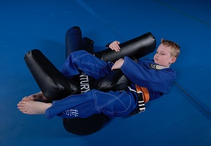 A child practices Brazilian jiu-jitsu on a Versys V.SPAR.2.