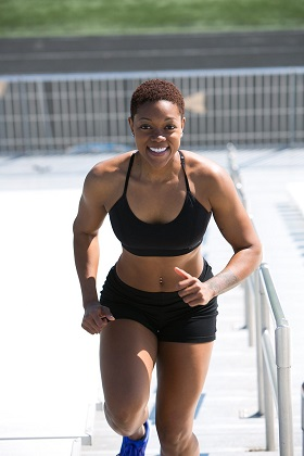 Woman running up steps cardio exercise.