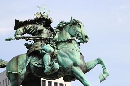 Image by Samuele Schirò from Pixabay. Statue of a samurai warrior astride a horse.