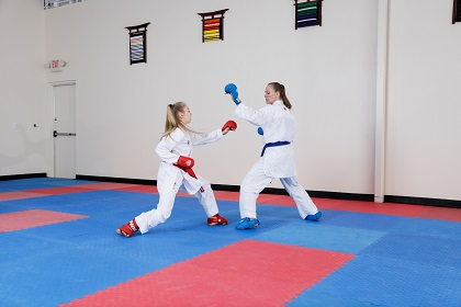 Karate sparring with Punok gloves and Century Martial Arts gi uniforms.