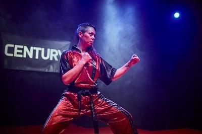 Sensei Jennifer Allman training a karate form.