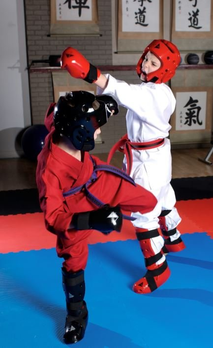 Children wearing Student Sparring Head Gear, Gloves, Boots and Shin Guards during training.