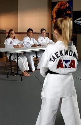 Girl in ATA American Taekwondo Academy gi Century Martial Arts.