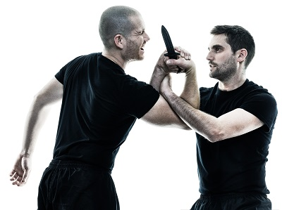self defense arts bka pic 1 martial arts training wrist lock with plastic training knife.