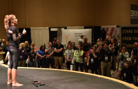 Katarina Conrad, founder of the HIIT & Run workout/self-defense program,                   gives a live demonstration on the tradeshow stage.