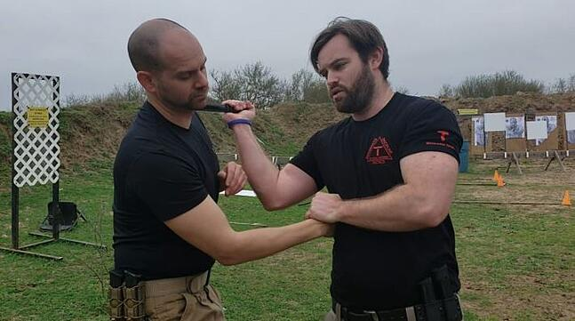 William Tresten and a partner training a close-quarters knife self-defense drill.