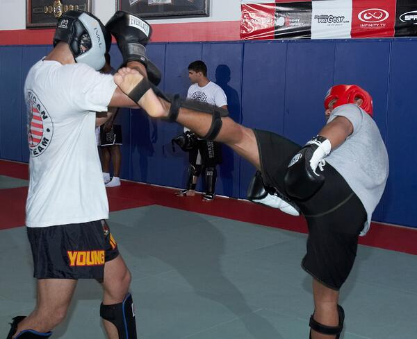 Students at American Top Team OKC practice MMA.