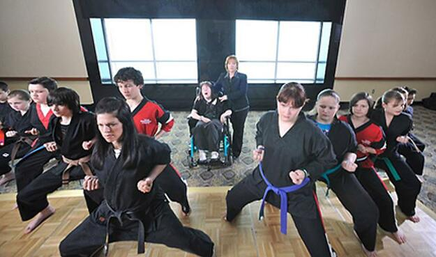 Tori and Cathy (center) at a martial arts class.