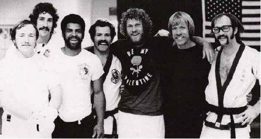 Pat Johnson (center) with Chuck Norris (second from right) and other students.
