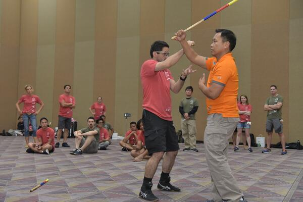 Master Apolo Ladra (orange shirt) demonstrates a kali pattern at the 2017 Martial Arts SuperShow.