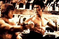 A young Bruce Lee and Chuck Norris fight in one of Lee's films.