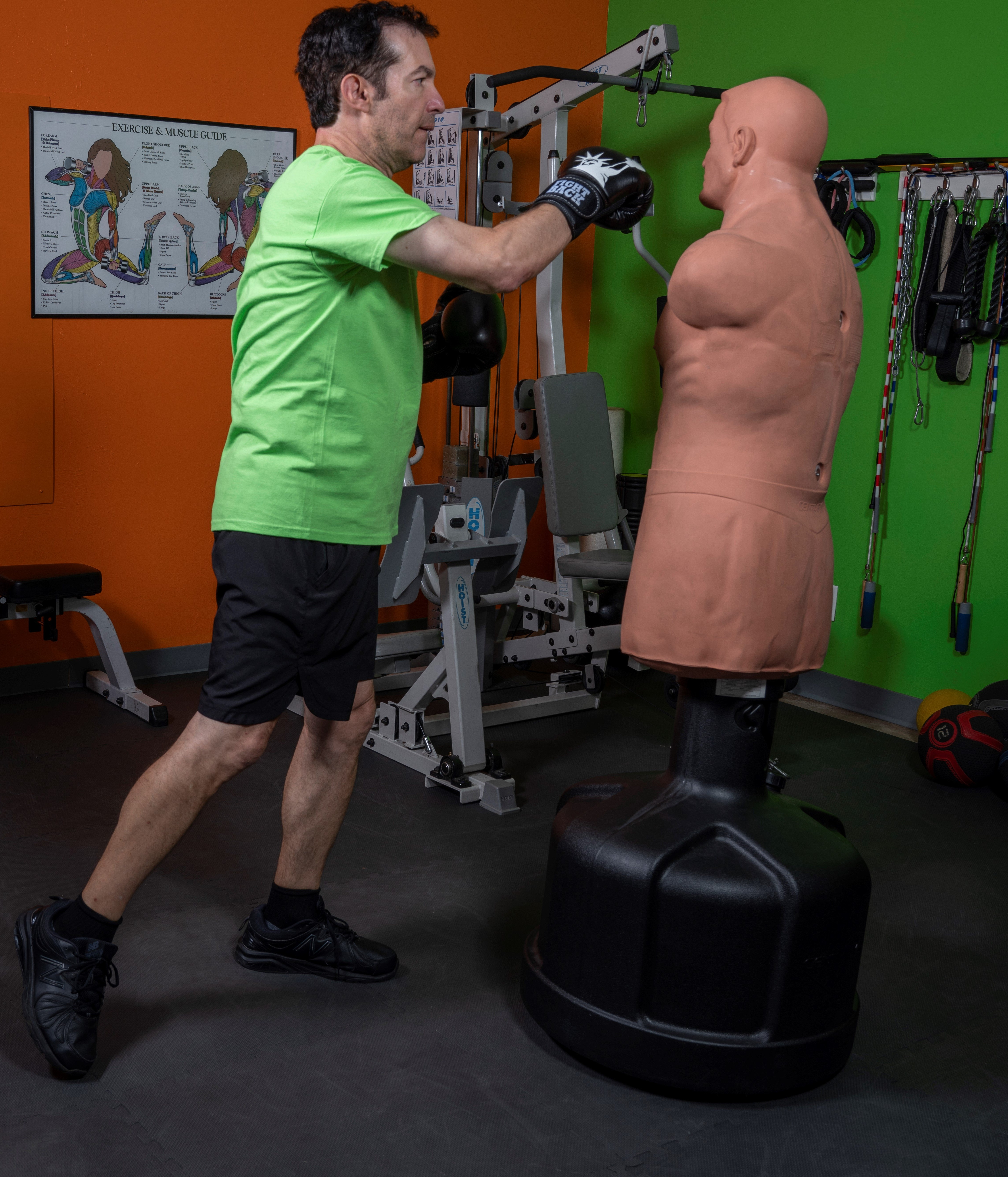 A Rock Steady Boxing member perfects his aim on the BOB Body Opponent Bag.