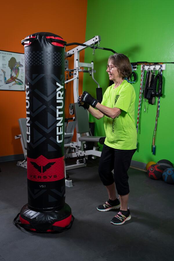A woman practices her boxing moves on the Versys VS1 bag from Century Martial Arts.
