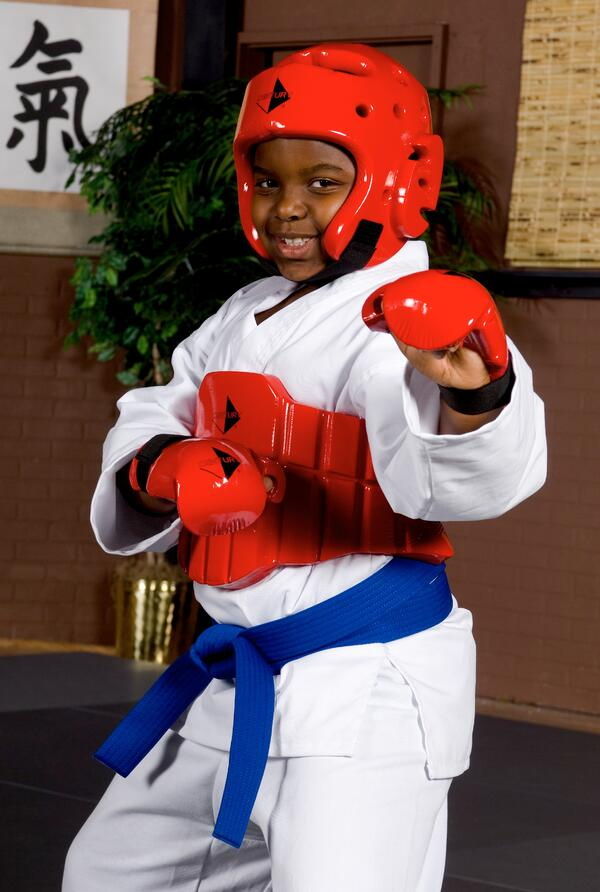 A student wearing Century Sparring Gear smiles, showing confidence.