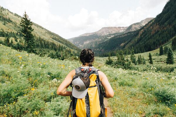 Outdoor activities such as hiking -- or even going for a stroll around your neighborhood -- can help curb addictive behaviors. Photo by Holly Mandarich via Unsplash.