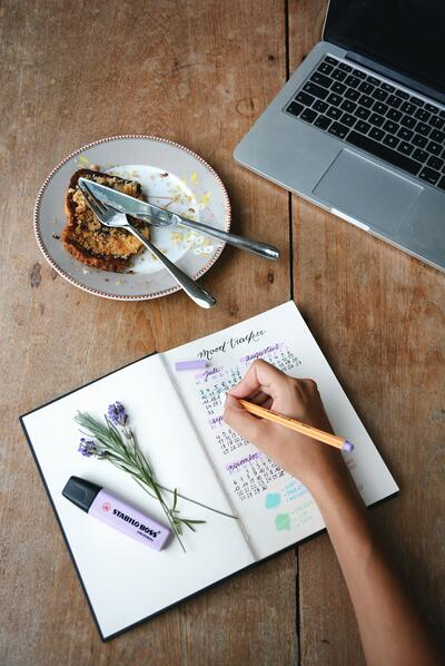 Keeping a routine, and a mood diary, will help you balance your schedule and the emotions that may lead you to a relapse. Photo by Estee Janssens via Unsplash.