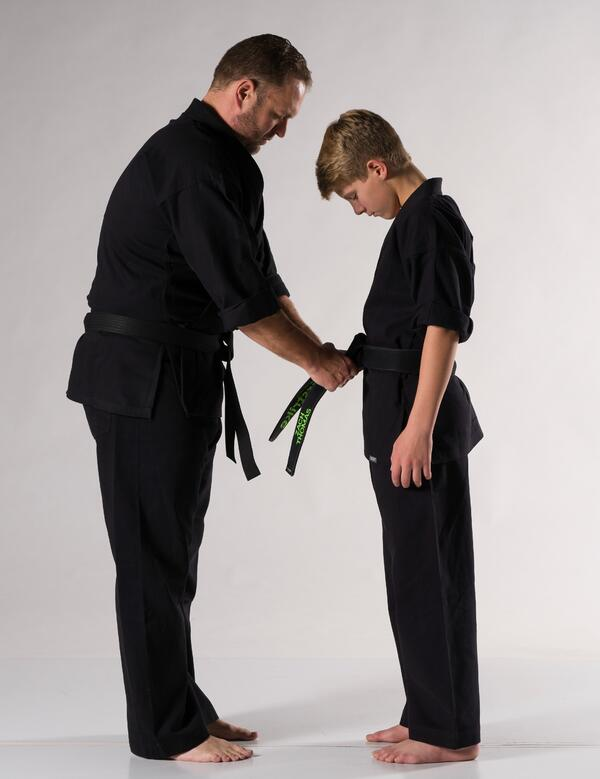 A young student receives a new belt.