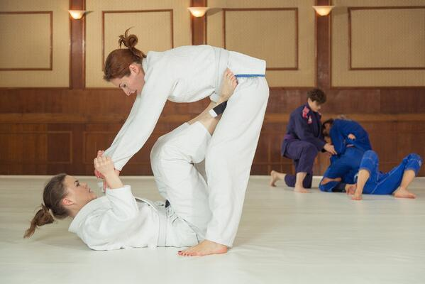 As new white belts, Brazilian jiu-jitsu students may prefer simple, lightweight gi uniforms.