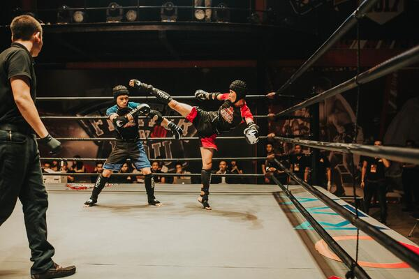 This is an actual, real kickboxing fight, by the way. Not sparring. Photo by Coco Championship via Pexels.