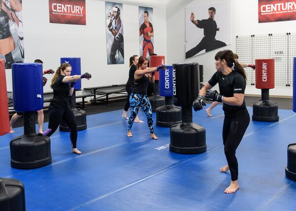 A cardio kickboxing class lets you kick bags, like these Wavemasters! Or it should. A class without bags is boring.