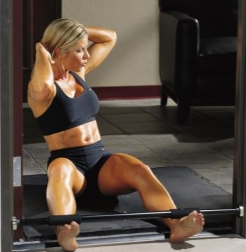 Woman doing crunches with weights.