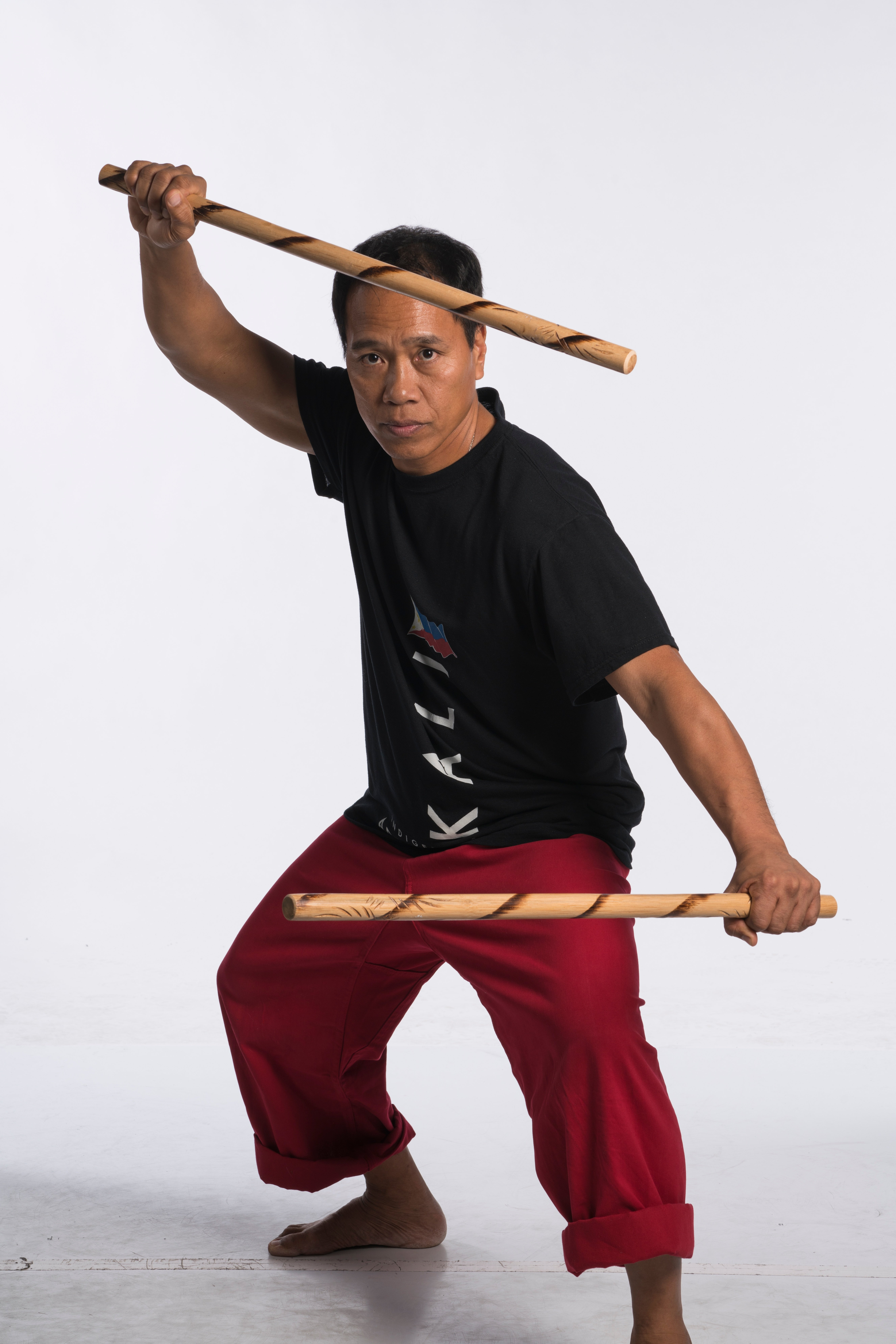 Kali master Apolo Ladra demonstrates a form used in the weapons art.