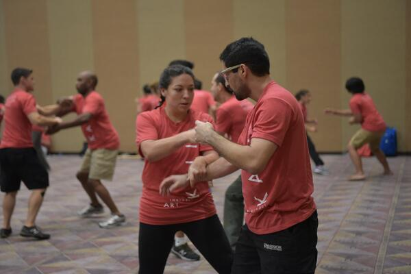 Two attendees at the 2017 Martial Arts SuperShow practice an unarmed kali drill.
