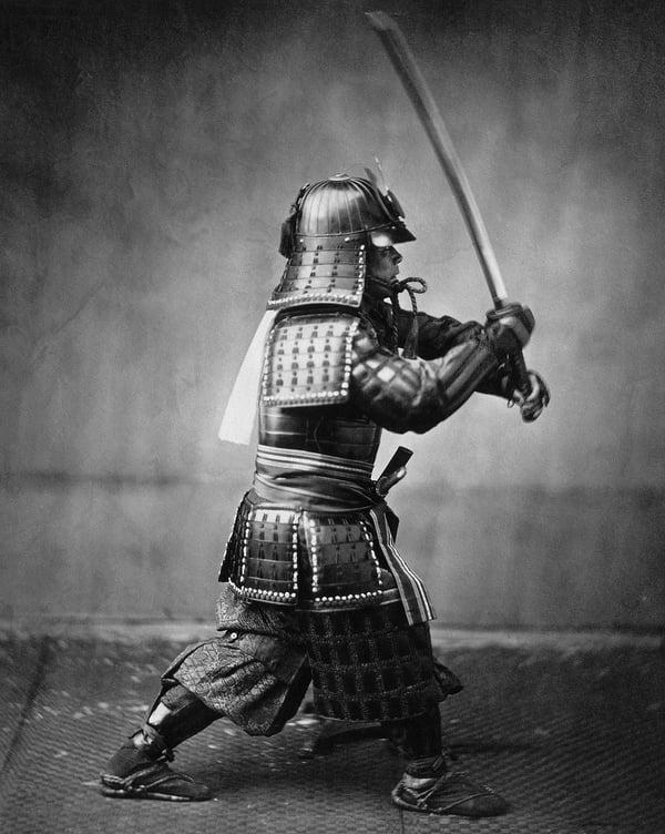 A samurai warrior wields his katana.