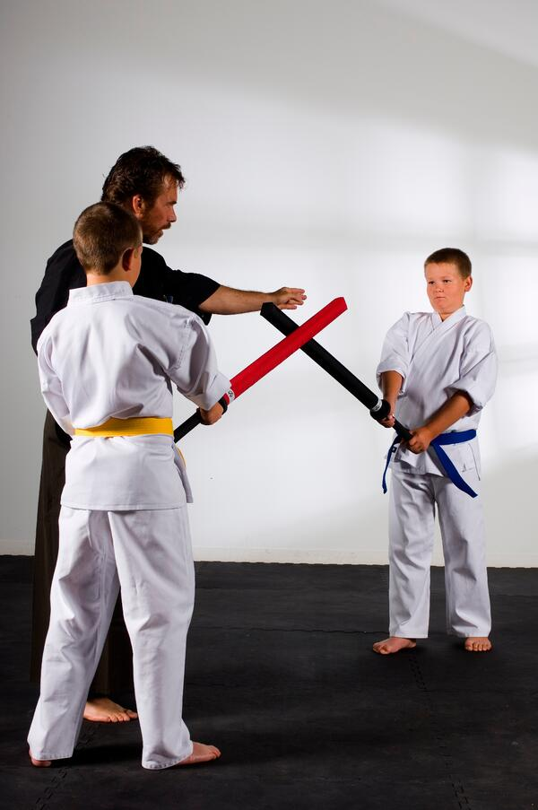 Youth practice sparring with foam katana under the instruction of Shihan Dana Abbott.