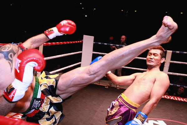 A Thai fighter narrowly dodges a kick. That would really have hurt.