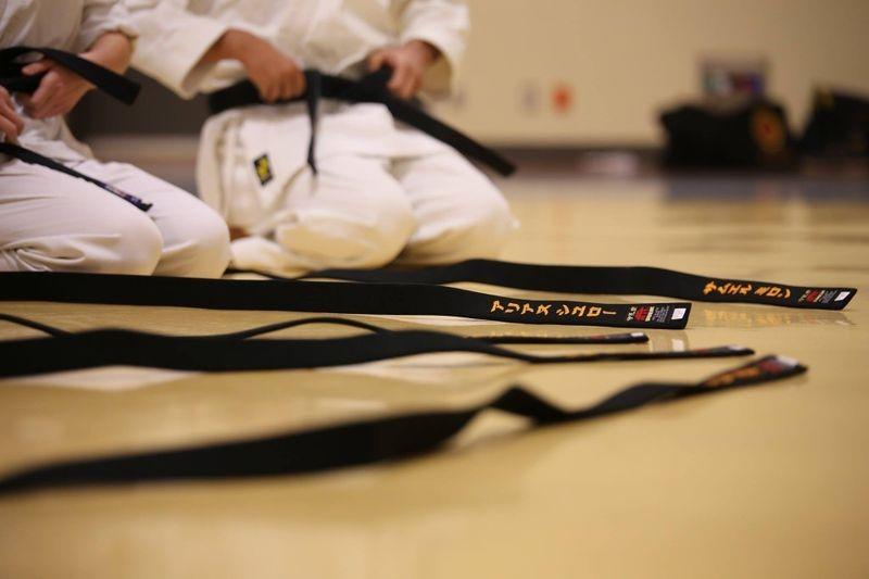 "The katakana on the belts say ""ARIASU SHIYUROO"" and ""SAMUERU (something) RON."" I have no idea what names those are."