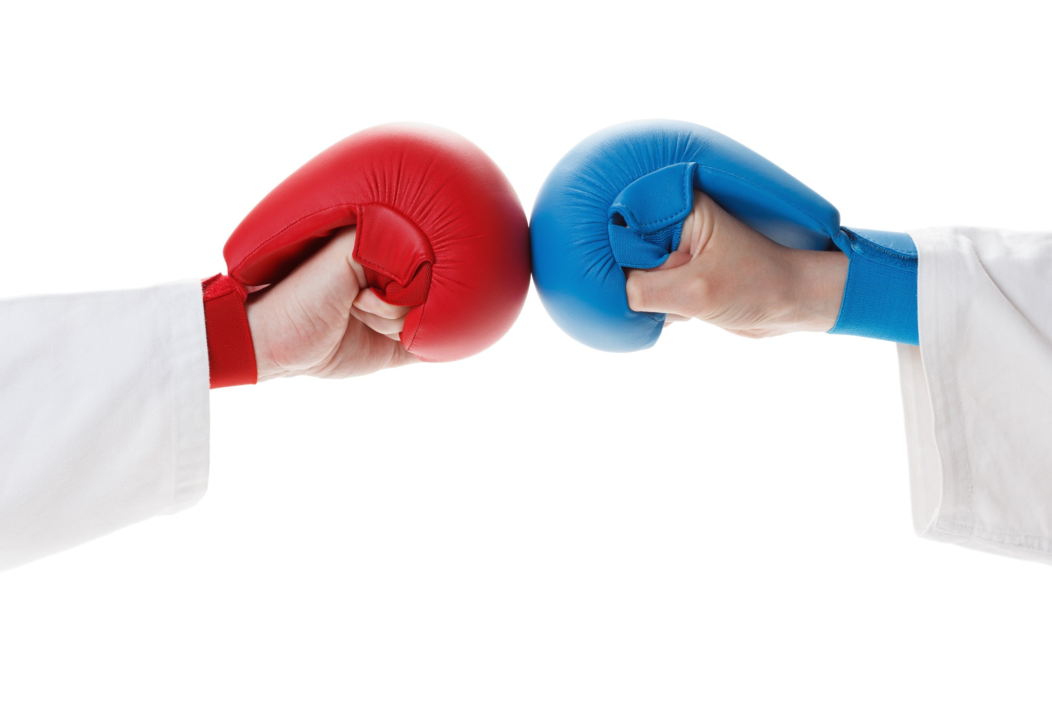 Students in karate gloves fist bump as they prepare to spar.