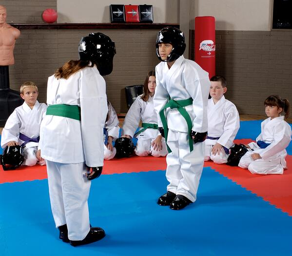 Two green belt students prepare to spar.