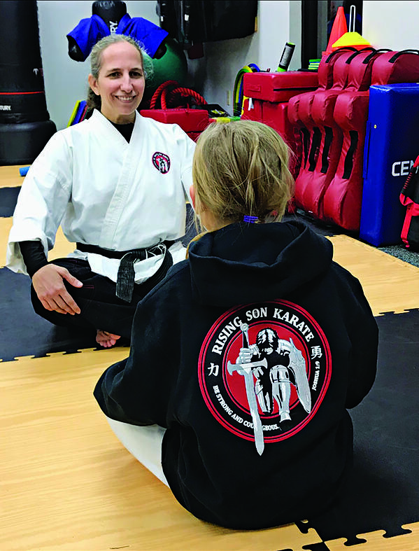 Twila Schuler and a student at Rising Son Karate.
