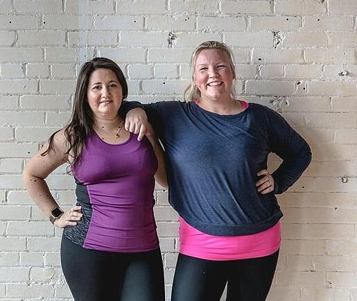 Two friends from a group fitness class.